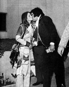 "October 9, 1973 - Former LA Times photographer George Fry shot the exclusive images of Elvis and Priscilla after one of his sources tipped him off. Fry walked up to the arriving Elvis and Priscilla, introduced himself as a photographer for the L.A. Times. They agreed to photos after the divorce-court hearing. When done in court, the Presleys came down the hallway ""smiling and smooching,"" Fry said. ""I had an exclusive,"" I'm the only guy to shoot this. No paparazzi anywhere."""