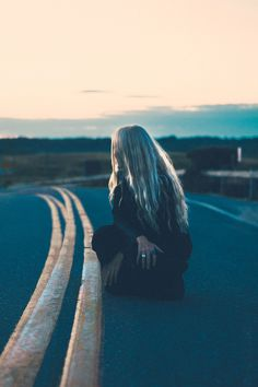 She felt the yellow lines in the middle of the out of the way road she'd been traveling near. Warm. As she was about to stand, she felt something else. Vibrations. She needed to leave. Now.