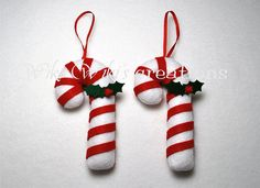 These adorable candy cane ornaments would look great in any Christmas Tree. Check out the rest of my Christmas Inventory in my shop.  * These candy canes are made of Eco-Friendly Felt and stuffed firmly with Polyfill. They stand about 5.5 Tall. (Keep in mind this item is handmade and no two are alike)  *****Message me if you would like different color candy canes or a different quantity******  * They are both machine and hand sewn and embellished with hand cut stiff holly leaves and shinny…