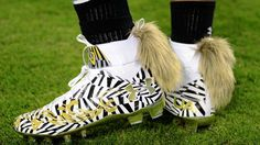 We need to talk about Cam Newton s fox tail cleats Cam Newton Outfit 7c26b547a0