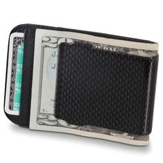 The Carbon Fiber Money Clip - Hammacher Schlemmer - This is the money clip made from carbon fiber that blocks credit cards from the latest identity theft technique: radio frequency hacking that attempts to read personal information from newer credit cards.