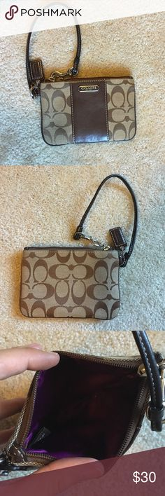 Coach wristlet Brown and tan Coach wristlet with purple interior fabric in great condition Coach Bags Clutches & Wristlets