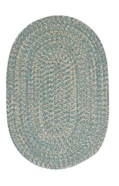 This round braided rug makes you just want to cozy up in front of the fire. The wool blend yarns create a textured softness and the natural color scheme coordinates with any decor.