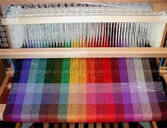On Elizabeth's Louet David loom at home, she wove the color sampler shown above. The loom was first warped with an 18-step color spectrum of...