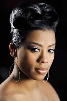 Keyshia Cole pinned up curl hairstyle