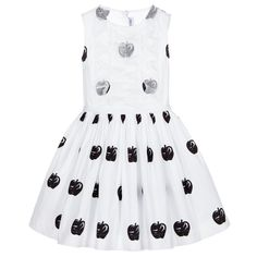 Girls white, cotton dress bySimonetta, with a black apple print and silk ruffles on the bodice. There is a white grosgrain ribbon running around the waist and a full, pleated skirt below. A silk frill on the cotton lining gives extra fullness to the skirt and there is a concealed zip at the back. Perfect for a smart occasion, teamed with patent pumps.