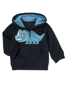 Add a cool layer with playful dinosaur details, comfy hood lining and front pockets.