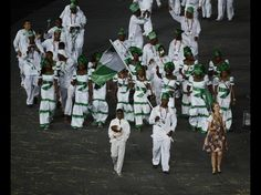 July 27, 2012; London, United Kingdom; Nigeria flagbearer Sinivie Boltic carries the flag during the Opening Ceremony for the 2012 London Olympic Games at Olympic Stadium. Mandatory Credit: Richard Mackson-USA TODAY Sports.  Credit: