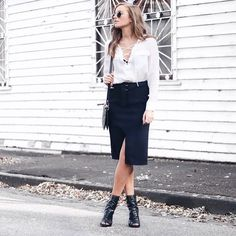 Lace up in a silky v-neck and wrap front midi