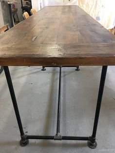 12 foot wood dining table Industrial pipe base  Made in two
