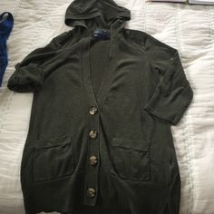 Dark Green Hooded Cardigan Excellent condition hooded cardigan.  Features tabbed sleeves (pictured up + down), patch pockets, 4 buttons + button detail on the shoulder. American Eagle Outfitters Sweaters Cardigans