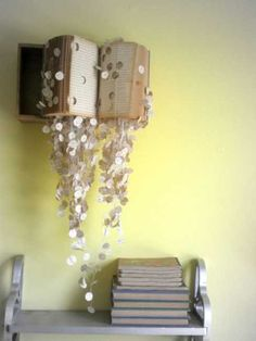 recycling paper for cheap decorations, book with paper garlands on empty wall