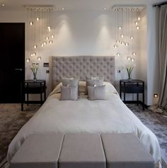 Warm grey bedroom with modern side chandeliers/pendant lighting