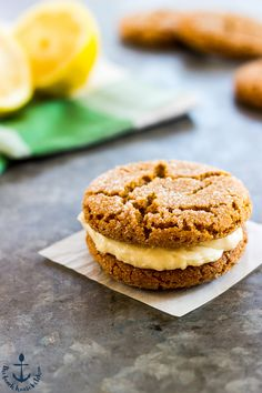 Giving the classic gingersnap a few tweaks for summer! These Lemon Gingersnap Sandwich Cookies have the perfect hint of fresh lemon and they're sandwiched together with some deliciously smooth vanilla buttercream!