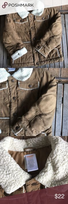 """Kids Gymboree Tan Snap Button Coat Kids Gymboree Tan Snap Button Coat. Great condition! Tan brown cotton with polyester lining. Faux shearling trim. Snap button closures. Four functional pockets. Sleeves can be rolled to show shearling trim. Length 20"""". Size S (5-6) Gymboree Jackets & Coats"""