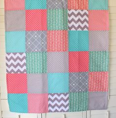 Baby Blanket - Baby Girl Baby Blanket - Fleece Blanket - Coral Pink, Teal Blue and Gray. $49.50, via Etsy.