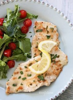 Chicken Francese, Lightened Up - Skinless chicken cutlets, lightly coated in flour and egg, cooked in a white wine lemon sauce. Move over Olive Garden, this one's lighter and easy to make!