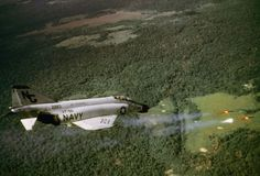 US Navy Phantom fighter bomber unleashes rockets against a Viet Cong position, 1968.