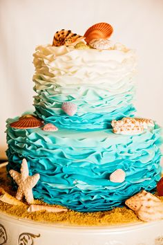 The nautical details on this Disneyland ombre ruffled cake makes us want to head to the beach!