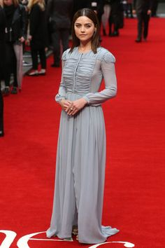 26 May Jenna Coleman joined her on the red carpet in a grey ruffled gown by Burberry and Nicholas Kirkwood shoes.