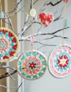 Crocheted Granny Christmas Decorations from Etsy.  These are so cute!!!!  Plus they hang from an adorable string with buttons!!
