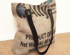 Made from an up-cycled burlap coffee sack, this eco-friendly tote bag includes one open interior pocket and secures with a silver magnetic snap Burlap Coffee Bags, Hessian Bags, Jute Bags, Diy Bean Bag, Diy Tote Bag, Reusable Tote Bags, Burlap Purse, Coffee Bean Sacks, Ethnic Bag