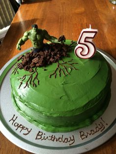 Easy Hulk Cake Green buttercream icing with crushed cookies around him. My 5 year old loved his cake!