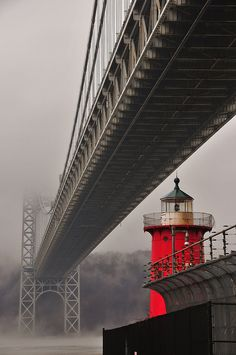 *Little Red Lighthouse stands under the George Washington Bridge.  (by Tim Schreier)