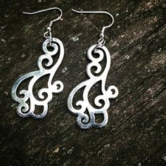 On these earrings are a pair of elegant silver cloud flourishes!  This was…