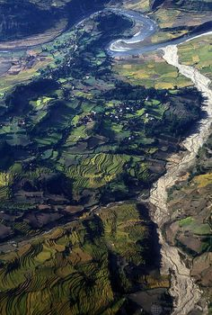 Aerial views of river and terraced fields