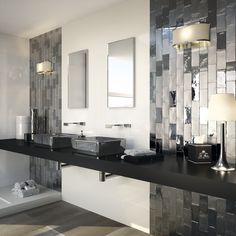 Eclectic ceramic mosaic tile in a metallic, silver PVD finish. Can be installed horizontally or vertically. Features a futuristic appearance almost resembling hot liquidized lead, the grey/silver looks like metal plating and will work great as a feature piece.