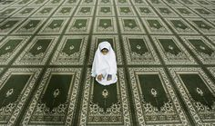 """A Palestinian Muslim girl prays in the men's mosque before the evening prayer called """"tarawih"""", during the holy fasting month of Ramadan in the West Bank city of Ramallah, Wednesday, Sept. 17, 2008."""