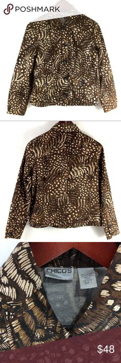 """Chico's Animal Print Denim Jacket Chico's Animal Print Denim Stretchy Jacket  Disclaimer: 1 of 2 sleeve cuff buttons on the right is missing.  Otherwise, Brand new without tags, perfect condition!!! 98% COTTON, 2% SPANDEX Collar. Button Front. Button Sleeves. 2 front flat breast pockets.  Beautiful big black buttons. Labeled a size 1 or Small, Roomy, exact measurements,  Bust: 40"""" Length: 23""""  Meant to be a layering piece.  ID caln9 Chico's Jackets & Coats Jean Jackets"""