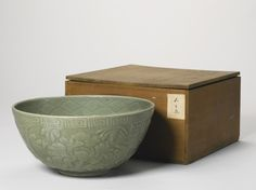 A LARGE 'LONGQUAN' CELADON CARVED 'PEONY' BOWL<br>MING DYNASTY, 15TH CENTURY | Lot | Sotheby's
