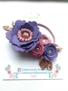 Purple Rose Flower Headband A beautifully soft headband made with pure wool felt flowers which have been personally hand rolled. Perfect for spring and complements PANTONE's colour of the year 2018- Ultra Violet This bouquet has been embellished with crystals and deluxe glitter