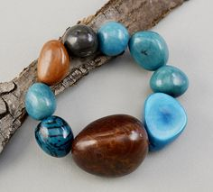Chunky bracelet with big brown and turquoise tagua nuts, bold elastic vegetable ivory bracelet, colorful large bracelet with organic beads by ColorLatinoJewelry on Etsy Nut Bracelet, Bangles, Beaded Bracelets, Big Brown, Christmas Gifts For Mom, Turquoise Bracelet, Ivory, Organic, Colorful