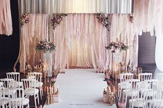 "Who wouldn't want to say ""I Do"" against this delicately draped pink ceremony setting? Swoon!"