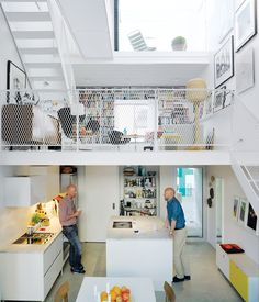 Any home can be considered a backdrop for its contents, but the Town House takes that principle to the extreme. With white walls, a white counter, and an off-white floor, this Swedish abode makes the colors of fruit, photos, and book covers pop, providing a new focal point at every turn. Photo byMark Seelen.