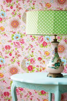 pink flower wallpaper  green lampshade blue table, for a girl's bedroom