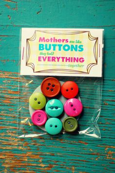 Mother's Are Like Buttons, They Hold Everything Together. Button magnets for all the art work/homework on the fridge!