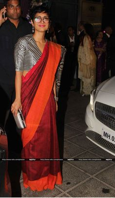 Filmmaker Kiran Rao looked elegant in red and orange raw silk sari teamed with monochrome blouse.