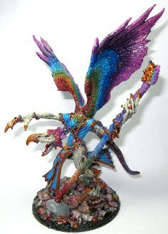 Lord of Change, a greater daemon of Tzeentch. Taste the Rainbow! :D Painted by Lanine K. McMurtry @shadowrose #Warhammer40k.