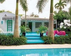 palms in pots and the painted deck to match the pool. I love this. How cute and Key West looking it is.