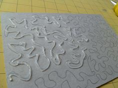 sketching out the design before you lay down your glue in making Hot Glue Stencils for monoprinting with Gelli plates