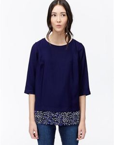 Joules Womens Woven Top, Navy.                     This double layer effect top is a classic style that comes with a little twist. The flattering shape has a ditsy print hem stitched into the bottom to lift it out of the ordinary. A must if you're looking for something different this season.