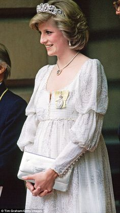 Frou-frou: Three-tiered sleeves on a maternity dress when she was pregnant with Harry