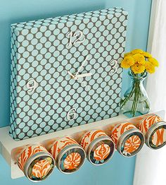 Stretch fabric over a small painter's canvas for a clock that coordinates with your decor. Staple the fabric to the back of the frame. Poke a hole through the center of the canvas. Assemble a clock kit following the manufacturer's instructions.