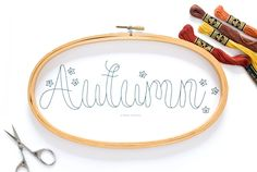 Download and stitch this free hand embroidery pattern for fall, featuring Autumn word art and a scattering of leaves.