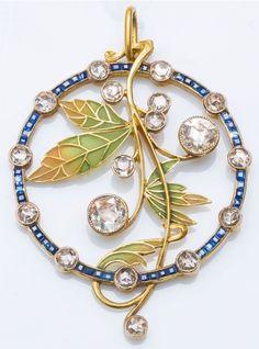 An Art Nouveau gold, enamel, diamond and sapphire pendant, attributed to Masriera. Diameter: 4.6cm. #Masriera #ArtNouveau #pendant