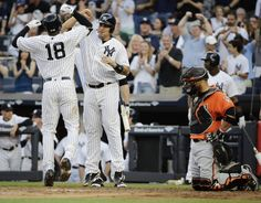 Judge, Yankees batter Orioles 16-3 for 4th straight win  -  June 10, 2017:    New York Yankees' Didi Gregorius (18) and Gary Sanchez celebrate a home run by Gregorius as Baltimore Orioles catcher Welington Castillo (29) reacts during the first inning of a baseball game Saturday, June 10, 2017, in New York. (AP Photo/Frank Franklin II)